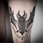 Arm bat tattoo