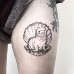 Baby seal on clam tattoo