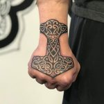Celtic cross hand tattoo