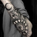 Goth men arm tattoo