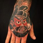 Japanese mask hand tattoo