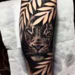 Lion jungle tattoo